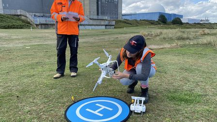 Sara Stones and Matt Eagle check the drone before it takes off to monitor coastal erosion at Sizewel