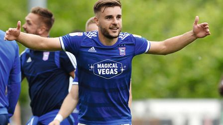Luke Garbutt celebrates at The Pirelli Stadium after Ipswich win on the first day of the season Pict