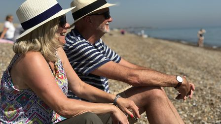 People enjoying the beach at Aldeburgh on the hottest day of the year so far. Picture: Neil Didsbury
