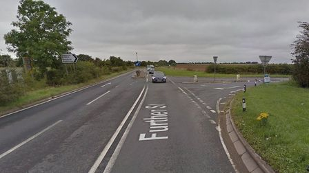 A red Ford car and a black motorcycle have been involved in a crash on the A134 near Sudbury, Pictur