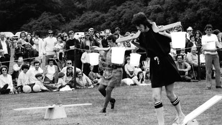 """A balancing act for contestants in an """"It's A Knockout"""" event at Hardwick Heath, Bury St Edmunds in"""