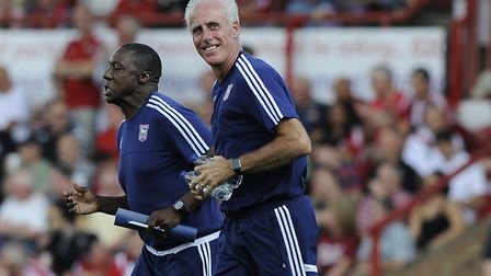 All smiles from Mick McCarthy as Ipswich Town prepare to start the second half at Brentford in Augus