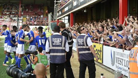 Ipswich Town fans celebrate a super start to the 2015/16 season at Griffin Park. Photo: Pagepix