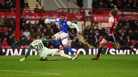 Collin Quaner hits the post at Griffin Park as Town slipped towards relegation. Photo: Pagepix