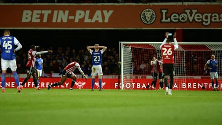 Flynn Downes holds his head after his slip led to Ollie Watkins for Brentford. Photo: Pagepix