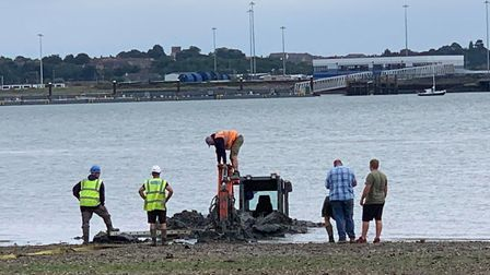 The digger stuck in the mud in Shotley Picture: SAMANTHA BATEMAN