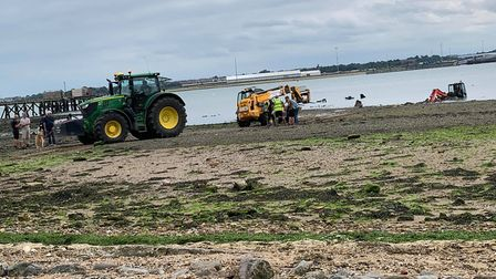 A tractor was called in to help the stranded digger Picture: SAMANTHA BATEMAN