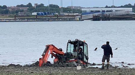 The digger had to be left until the tide subsided Picture: SAMANTHA BATEMAN