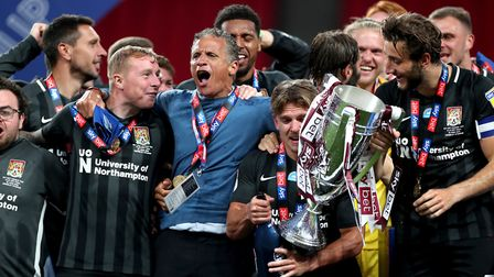 Northampton Town players and manager Keith Curle lift the League Two Play-Off Final trophy at Wemble