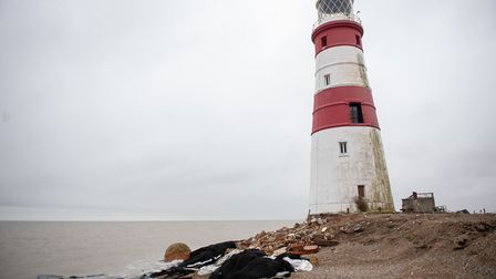 The demolition of the historic Orfordness lighthouse has begun before it tumbles into the sea. Phot