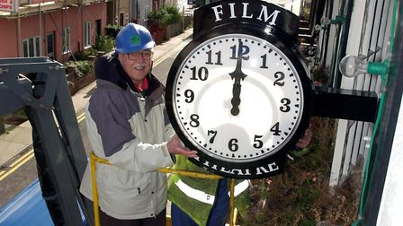 Frank Huxley, Chairman of Leiston Cum Sizewell Town Council, helping to put the town's cinema clock