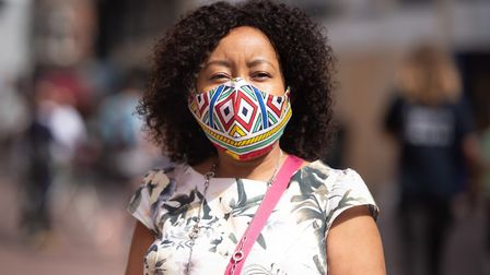 Kele in her brightly coloured face mask ready to shop in Ipswich. Picture:SARAH LUCY BROWN