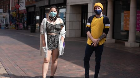 Maia Bates and Daniel Owen in their masks in Ipswich town centre. Picture:SARAH LUCY BROWN