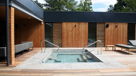 The spa features a south-facing deck, hot tub and sun loungers Picture: CHARLOTTE BOND