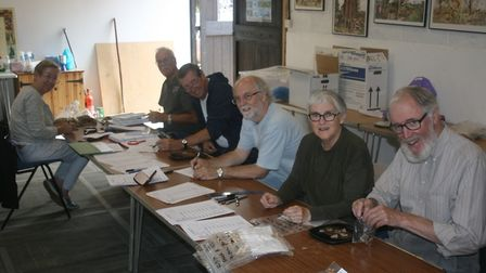 The Stour Valley Community Archaeology group processing finds from its Gestingthorpe dig Picture: SV