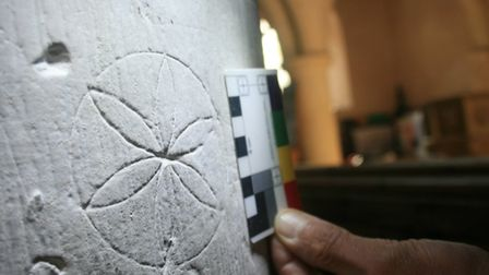 The geometric daisy mark that the Stour Valley Community Archaeology group keeps finding in medieval