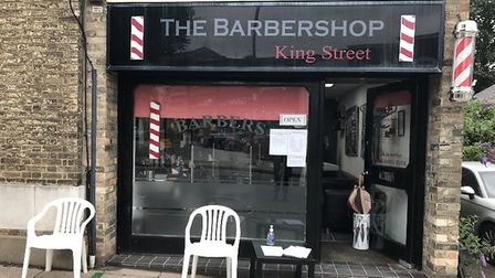 The Barbershop's King Street location, with floor markers on the pavement, hand sanitiser by the doo