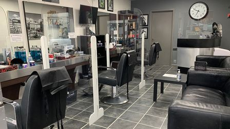 Perspex screens seperating customers are just one of the many ways that The Barbershop is ensuring i