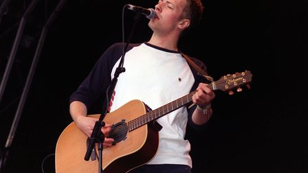 Chris Martin, lead singer of the pop band Coldplay, performs on stage at the Glastonbury Music Festi