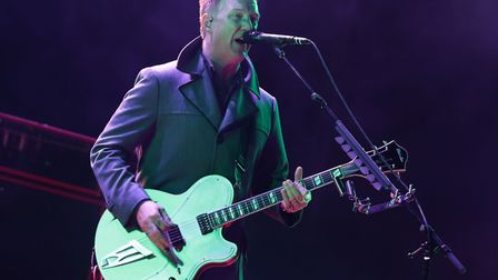 Josh Homme of Queens of the Stone Age performing on the Main Stage, at the Reading Festival, at Litt
