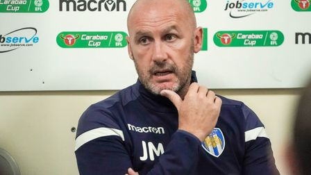 Colchester Team Manager John McGreal pictured during the post match press conference after his side