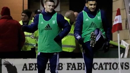 Idris El Mizouni (right) and Tommy Hughes and warm-up during Ipswich Town's 1-0 win over Lincoln Cit