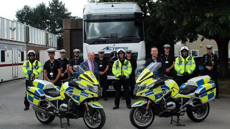 Suffolk police and crime commissioner Tim Passmore with officers from Operation Wyken Picture: SUFF