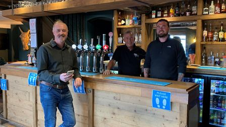 The OpenInn app in action at The Bull in Bacton with from left, Peter Reeves, Duncan McRae and Rory