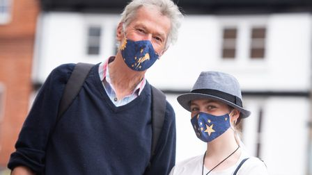 Stephen King and his granddaughter Tilly McCall wore masks while shopping in Sudbury Picture: SARAH