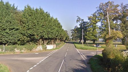 The Street is closed in Cavenham after a Ford Mondeo was left on its roof following a crash with a c