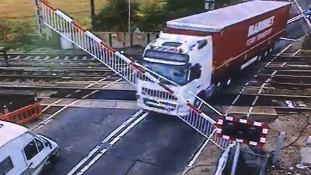 A lorry has crashed through the barriers at the level crossing in Manningtree. Picture: NATIONAL RAI