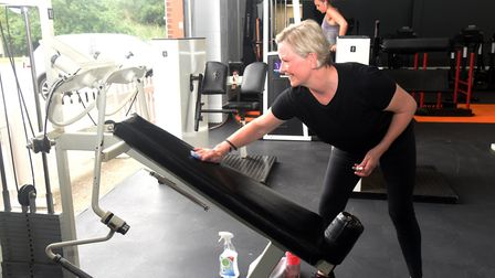 Jo Weeden cleaning down some equipment after her workout. Live Fit gym in Lawford was one of those t