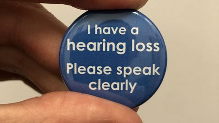 Matthew Coward, operations manager at The Hearing Care Centre, with one of the free badges. Picture:
