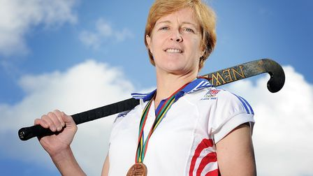 '92 Olympic hockey bronze medalist Kath Johnson, with her medal and olympic shirt. Picture: Matthew
