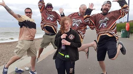 India Langley gets a cheer from fellow members of Mid Suffolk Mutts Skater Hockey Club at Felixstowe
