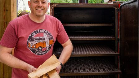 Adrian Nuttall with the Texas-style charcoal and wood smoker at Smokehouse Barbecue in Mendlesham Pi