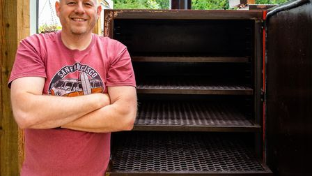 Adrian Nuttall with the Texas-sized traditional charcoal and wood smoker at Smokehouse Barbecue, Men
