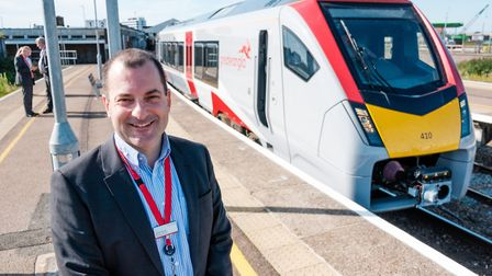 Greater Anglia managing director Jamie Burles with one of the new bimode trains at Lowestoft station