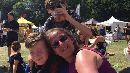 Kayden Cantlow (left) with his mum Michelle and his brother Francis. Picture: CANTLOW FAMILY