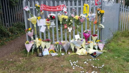 Flowers and messages have been left in tribute to Kayden Cantlow, 14, at the railway track in Colche