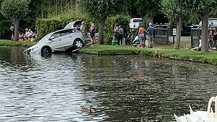 A car was driven into the Meare in Thorpeness after the driver lost control and crashed through a fe