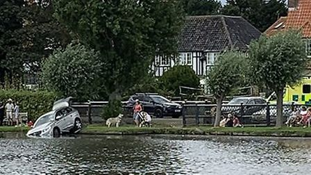 A car has driven into the Meare in Thorpeness after the driver lost control and crashed through a fe