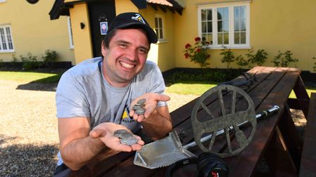 Luke Mahoney and his friends discovered the coins near a Suffolk pub Picture: MINELAB METAL DETECTOR