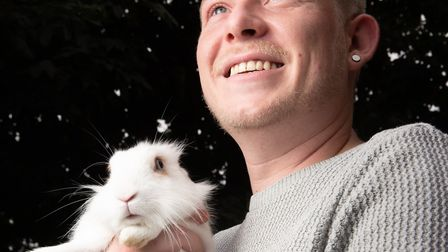 Robbie with his rabbit Domino, who appears in some of his acts Picture: SARAH LUCY BROWN