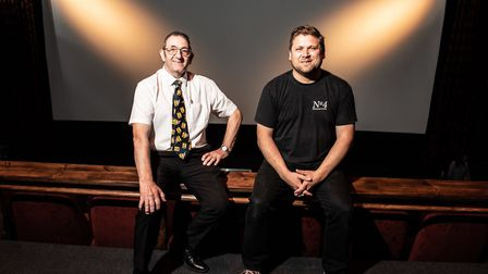 Pat Church and Chris Peters in front of the brand new screen at the Abbeygate Cinema Picture: SARAH