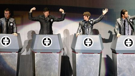 (left-right) Gary Barlow, Jason Orange, Mark Owen and Howard Donald of Take That performing in conce
