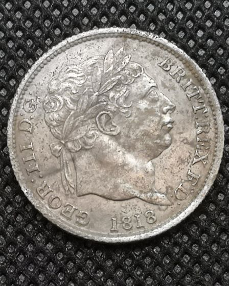 A George III 'bullhead' shilling from 1818 - Joe's first detector find Picture: Joe Edwards-Gill