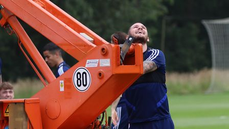 Prankster James Norwood commandeered the keys to the crane which had Ipswich Town's video analyst in