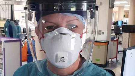 Lisa Bioyle in full PPE for dealing with coronavirus cases. Picture: LISA BOYLE