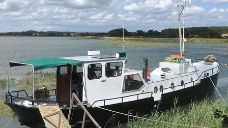 This Dutch barge moored at Ramsholt is available for �49,900 Picture: CLARKE & SIMPSON